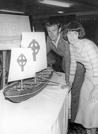 Explorer Tim Severin and his wife Dorothy beside a model of the kind of boat that a 6th century Irish monk could have used to sail to America.