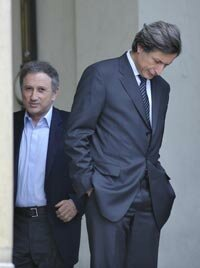 TV producer Michel Drucker (left) and President of the France Télévisions Group, Patrick de Carolis after a report on Internet taxation.
