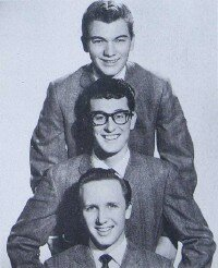 Bespectacled Buddy Holly, with the Crickets, Jerry Allison (top) and Joe B. Mauldin (bottom). Holly's music influenced John tremendously.