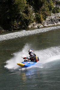 Shaun Baker pilots his jet kayak down a river.