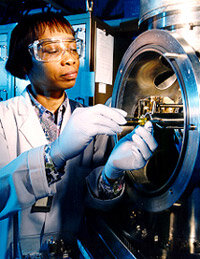 A researcher prepares samples for mass spectrometry research.