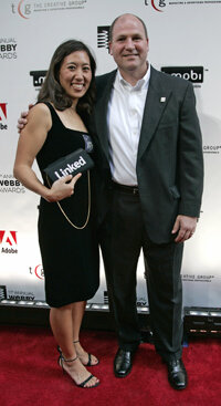 LinkedIn CEO Dan Nye and a guest walk the Webby Awards red carpet on June 5, 2007.