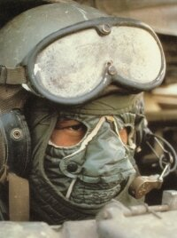 This M-60A3 loader wears a cold weather face mask while standing in the loader hatch in the turret.