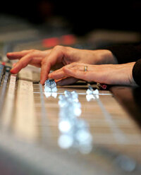 Control knobs on mixing boards help engineers set different levels for MIDI recording.