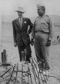 Nuclear physicist Robert Oppenheimer, left, with Major General Leslie Groves, by the remains of the tower from which an atom test bomb was ignited.