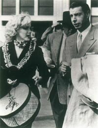 On January 14, 1954, Marilyn and Joe DiMaggio were married. Here, the honeymooners at Tokyo International Airport.