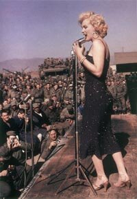 The temperatures in Korea were bitter cold during the four days Marilyn performed, but she said later that she felt only the warmth of the adoring soldiers.
