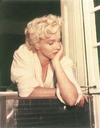 A candid shot, snapped during the filming of the final scene of The Seven Year Itch.