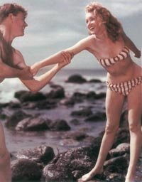 A bikini swimsuit of the type Norma Jeane wears here was quite rare on the nation's beaches at the time.