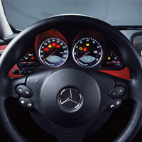 The SLR sports a multifunction steering wheel with F1-style manual gearshift buttons.