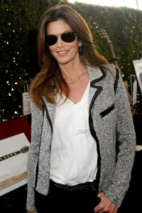 Super model Cindy Crawford modernizes a Chanel-esque tweed jacket with a pair of jeans and white T.