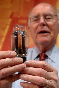 Gordon Moore holds a vacuum tube, the precursor to transistors.