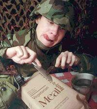 "1999 Military Photographer of the Year winner, ""Combat Cuisine""."