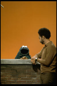 """Actor Matt Robinson (as Gordon) chats with Cookie Monster on """"Sesame Street."""""""