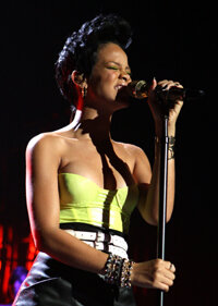 "Rihanna performs a song that includes a chorus of Stevie Wonder singing ""Superstitution."""