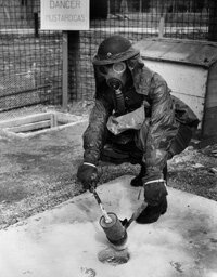 Scottish police officer all suited up to handle mustard gas