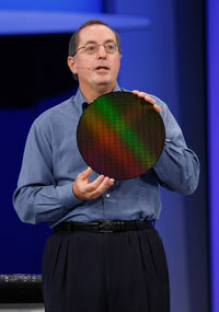 Intel CEO Paul Ortelli holds a wafer of computer chips with 32-nanometer circuitry.
