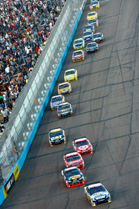 Cars speed through the NASCAR Sprint Cup Series.