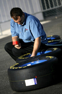 A crew member works on tire air pressure during testing at Daytona International Speedway in Daytona Beach, Fla.
