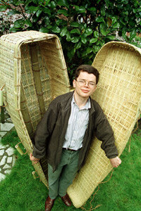 The designer of an eco-friendly bamboo coffin shows off his wares at the Natural Death Centre in North London.