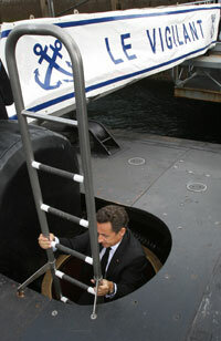 President Nicolas Sarkozy of France boards Le Vigilant, a nuclear-powered submarine, on July 13, 2007, during his visit to the Ile Longue Defence, a French navy base.