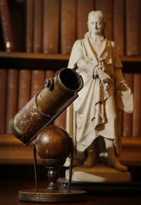 Newton's telescope rests next to a statue of the great man at the Royal Society in London.