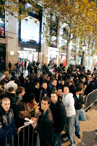 People wait in front of a store in Paris for the Wii to go on sale in December 2006.