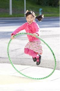 Kids can use a hula hoop for jumping or skipping as well as hula-hooping