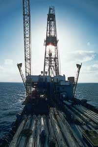 Drill ships like this one are often used to drill exploratory wells into suspected petroleum deposits. Note the drill pipe segments stored on deck.