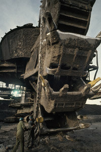 Excavators dig up oil sand that holds valuable bitumen. See more oil drilling pictures.