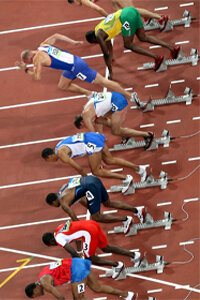 Competitors start the second heat of the men's 110-meter hurdles at the 2008 Beijing Olympics. The competitor wearing number 7 appears to have jumped the gun.