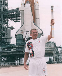 Kennedy Space Center Shuttle Operations Manager Loren J. Shriver carried the 1996 torch to the top of a launch pad.