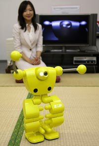 "An officer of robot venture company ZMP displays surveillance humanoid robot, ""Nuvo,"" in Tokyo, Japan."