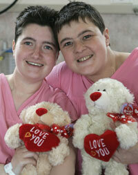 Sisters Carol and Tracey Playfair recover together after surgery. Tracey donated a kidney to save Carol's life.