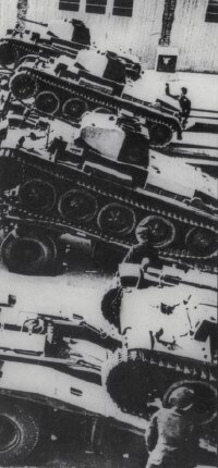 The Panzerkampfwagen II, shown being loaded onto a transporter, weighed about nine tons.