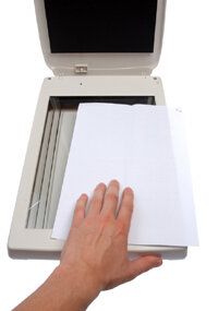 To create a paperless office, documents can be scanned into digital format using a scanner.