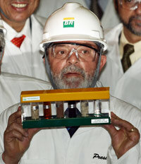 Brazil's president, Luiz Inacio Lula da Silva, holds up a sample of ethanol made from sugar cane, a biofuel -- one of the runners in our allegorical marathon.