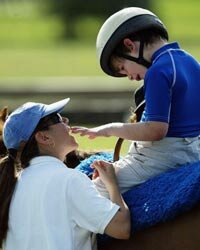 Michael Dedrick-Dwyer, who has autism, takes 30-minute ride on a horse with therapist Rebecca Reubens in Coconut Creek, Fla.