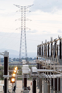 "The place where electricity converts from ""transmission"" to ""distribution"" occurs is in a power substation."