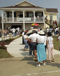 People line up to tour a modular home in New Orleans in 2006.