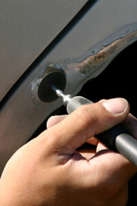 A grinder is a useful tool when you need to remove every speck of rust from your car.