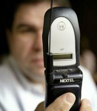 A Nextel customer looks over a Motorola telephone.