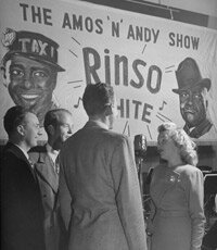 "A quartet sings during a commercial to advertise ""Amos 'n' Andy."""