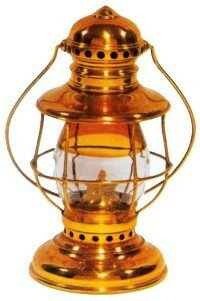 "Most hand lanterns were made of pressed steel or tinplate. A few, often called ""presentation lanterns"" because they were retirement or promotion gifts, were of brass. Style-conscious train crews might use a fancy lantern as a snow of pride."