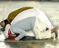 Muslims bowing in prayer