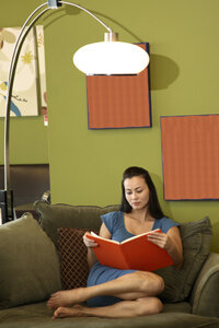 Though reading in dim light won't ruin your eyes, you'll be more comfortable with a good lamp.