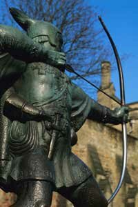 Tourist Attractions Image Gallery This Robin Hood statue is stationed outside of a castle in Nottinghamshire, England. See more pictures of tourist attractions.