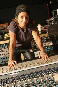 Professional musicians like Linda Perry rely on the sophisticated equipment found in recording studios for their recording sessions. See more recording studio pictures.