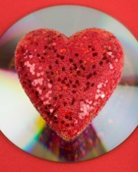 A big, red and shiny heart on a CD/DVD.
