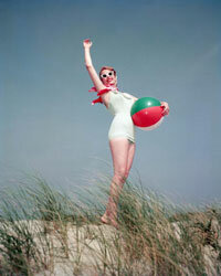 If you're going 1956 retro, ditch the water shoes -- cat eyes, a scarf and the requisite beach ball complete the look.